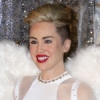 Miley Cyrus Celebrates New Years Looking Like Dolph Lundren MIxed With Brigette Neilsen
