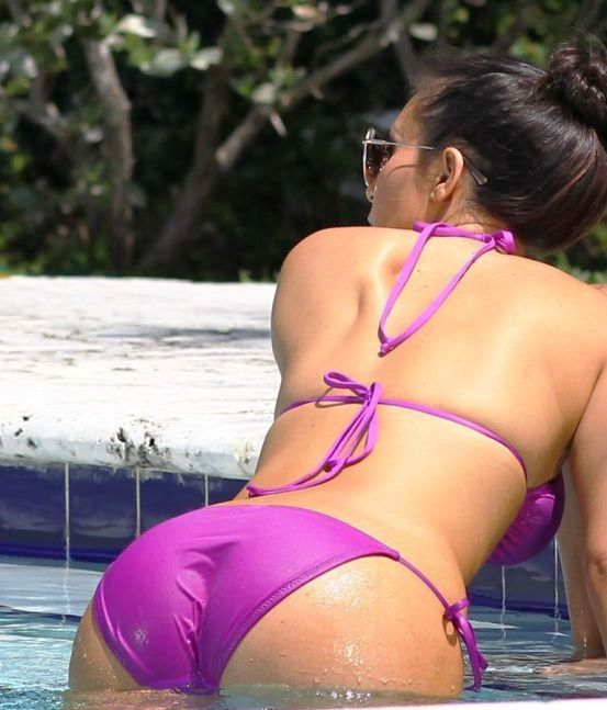 Kim Kardashian's full ass hanging out of her thong swimsuit