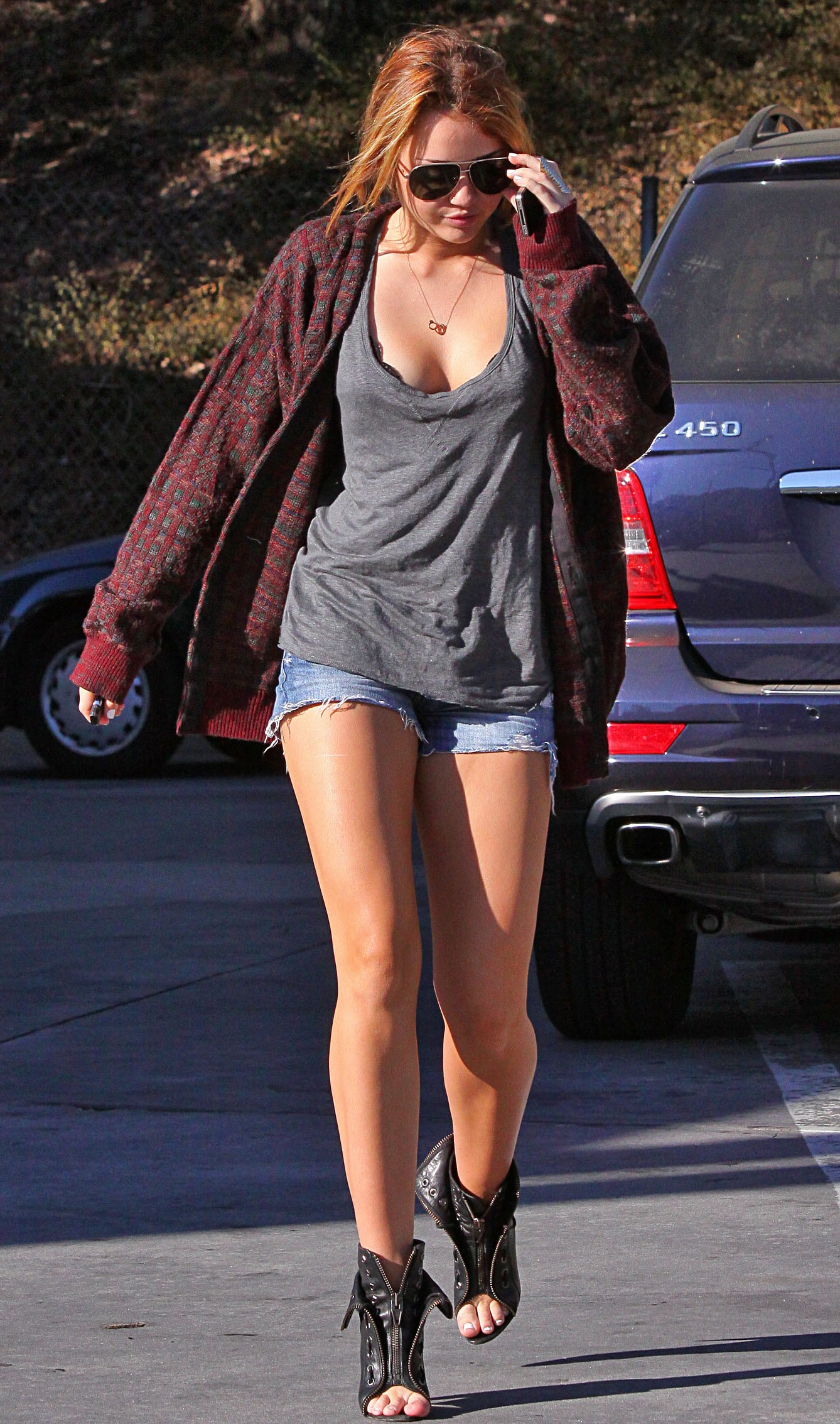 miley cyrus cleavage Miley Cyrus In A See Thru Shirt & Short Booty Shorts