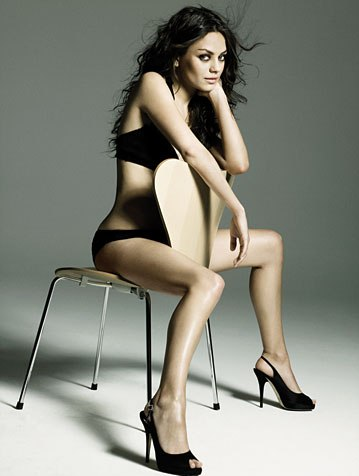 mila-kunis-straddles-chair