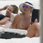 kate bosworth topless beach 150x150 Kate Bosworth Makes Retarded Faces While Topless Nude Swimming At The Beach