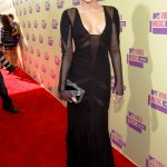 Singer Miley Cyrus arrives for the 2012 MTV Video Music Awards in Los Angeles, September 6, 2012.  REUTERS/Mario Anzuoni    (UNITED STATES  - Tags: ENTERTAINMENT)  (MTV-ARRIVALS)
