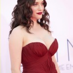 """Actress Kat Dennings, of the comedy series """"Two broke Girls,"""" arrives at the 64th Primetime Emmy Awards in Los Angeles"""