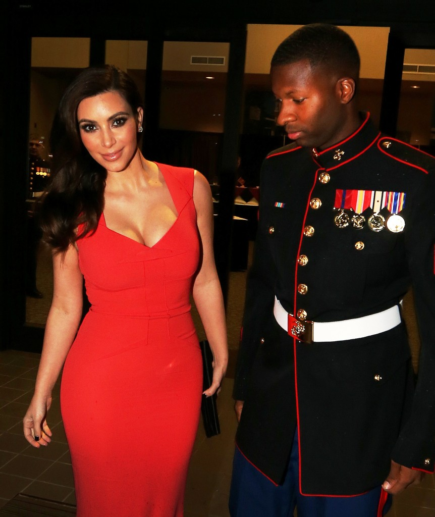 Kim Kardashian attends the Marine Corps Ball with Sgt Martin Gardner in Greenville, NC. Sgt Gardiner could'nt keep his eyes off his A-list date as they posed for photographs. Kim, wearing a stunning Roland Mouret red dress arrived at the ball and stayed for dinner before leaving solo and headed back to her hotel. Pictured: Kim Kardashian and Sgt Martin Gardner Ref: SPL458343  151112   Picture by: Aaron St. Clair / Splash News Splash News and Pictures Los Angeles:310-821-2666 New York:212-619-2666 London:870-934-2666 photodesk@splashnews.com